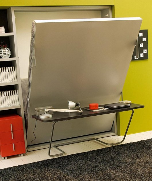 This murphy bed by Clei keeps the desk level as it folds down so you can leave your work in place.